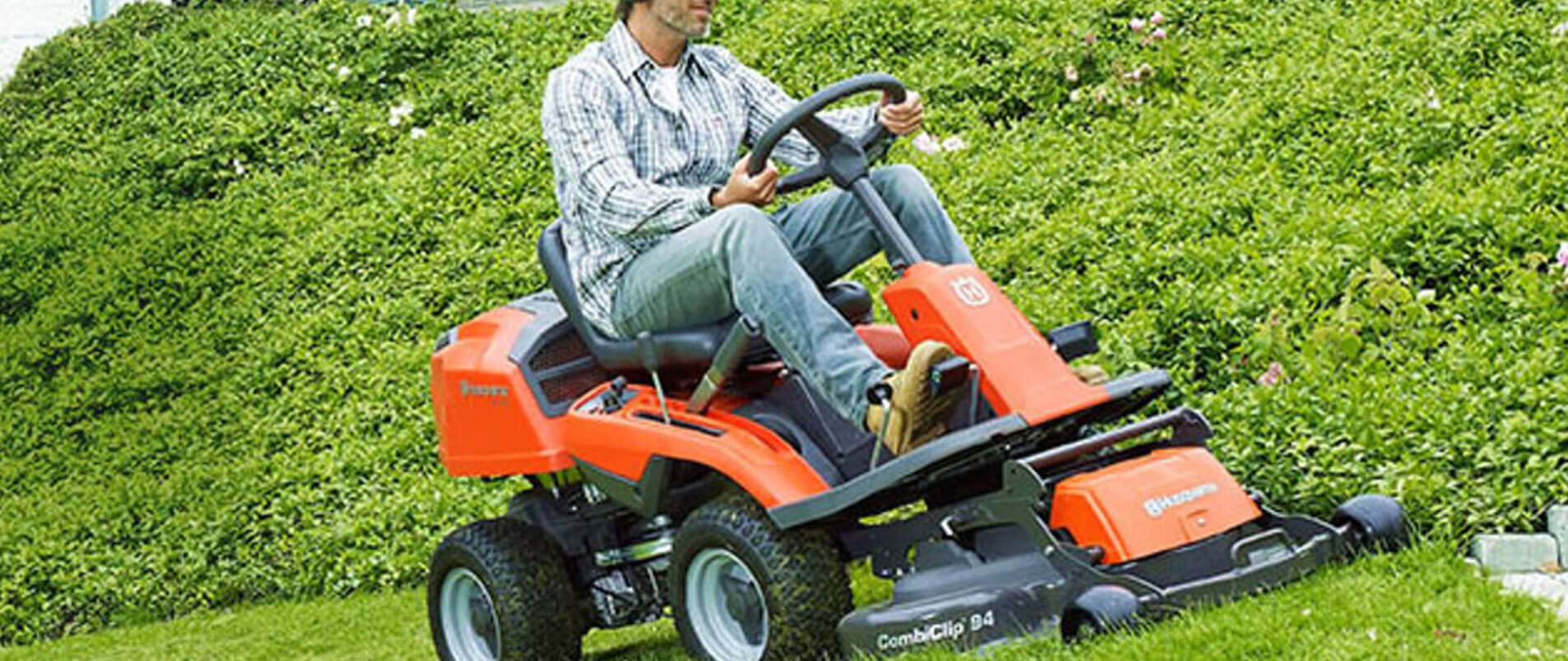 cutting grass with sit on mower